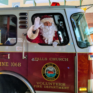 Santa Waving from the Window of a Fire Truck