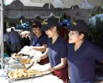 People serving food at Fall Fest