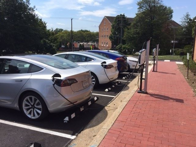 Four cars at EV chargers at City Hall