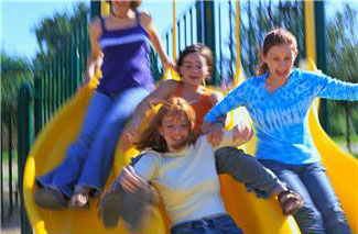 Children sliding down slide